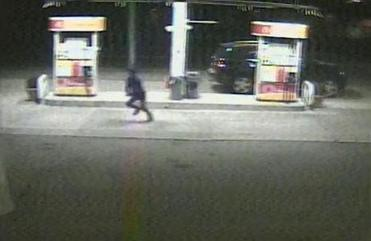 Dun Meng is pictured escaping from his crajacked Mercedes in an image from a video surveillance camera at a Shell gas station.